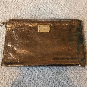 Micheal kors large bronze leather clutch
